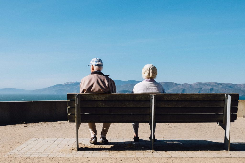 older man and woman on a bench metaphor for aging and ageism