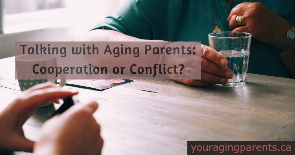 hand of two women at a table with title of article talking with aging parents.
