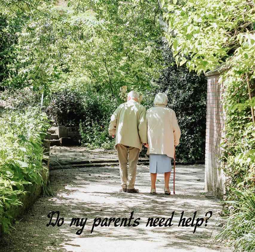 Elderly couple walking on a path in a park. Label Do my parents need help?