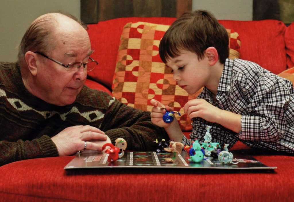 grandfather & grandson playing game